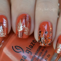 attractive-orange-nail-art-design-idea-with-brown-and-silver-fall-flowers-motif-and-rhinestones-ornaments-fall-nail-art-designs