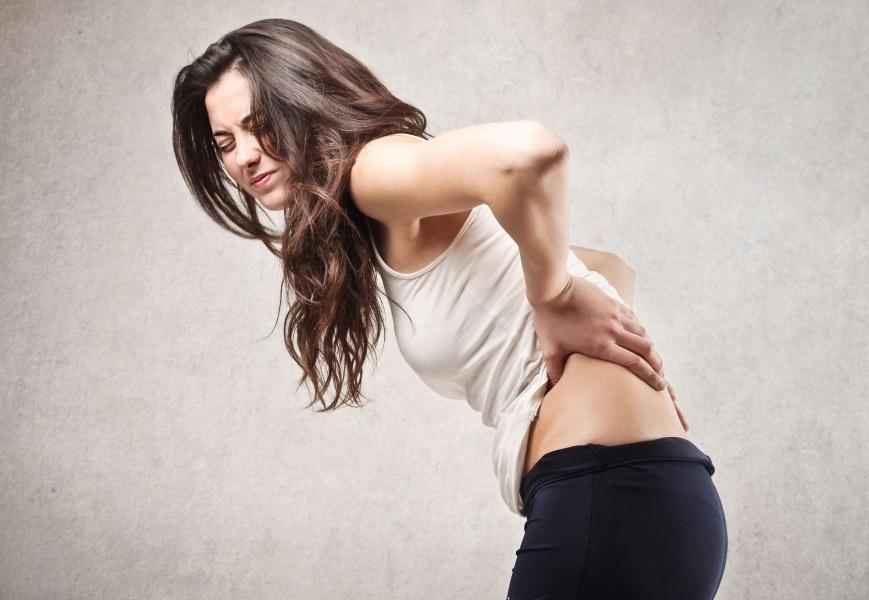 Чем объясняются боли в пояснице в первом триместре беременности?