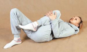подтягивание ног к себе